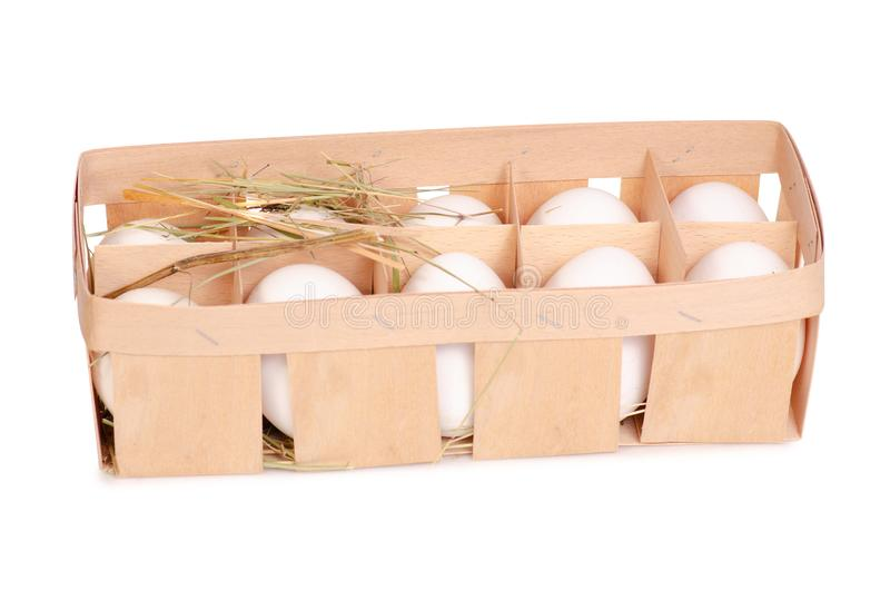 Chicken eggs in a wooden box of hay royalty free stock photo
