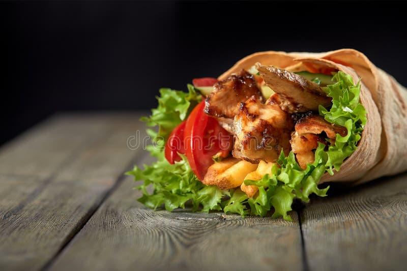 Chicken fajita wrap sandwich. Sandwich with fajita chicken. Roll with chicken meat fresh tomatoes and cucumbers, lettuce royalty free stock photography