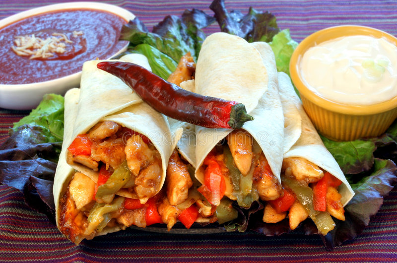 Chicken Fajitas. Four stacked delicious and appetizing chicken fajitas