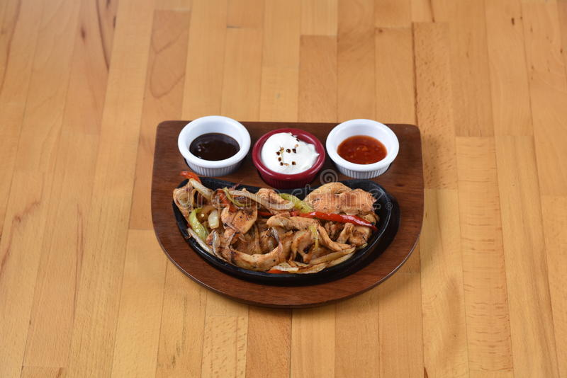 Chicken fajitas. Served with barbeque sauce, beans and ketchup stock photography