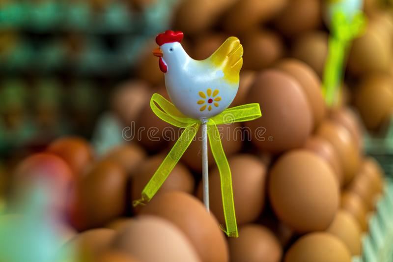 Chicken figurine with eggs around royalty free stock photography