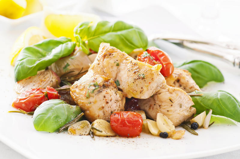 Chicken fillet. With garlic and tomato royalty free stock photography