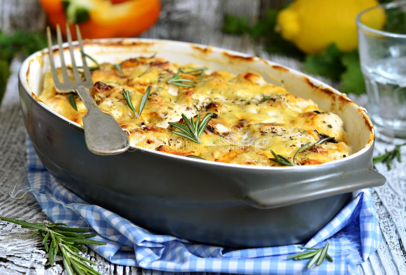 Chicken fillet baked in sour cream sauce. Chicken fillet baked in sour cream sauce with herb and cheese stock photos