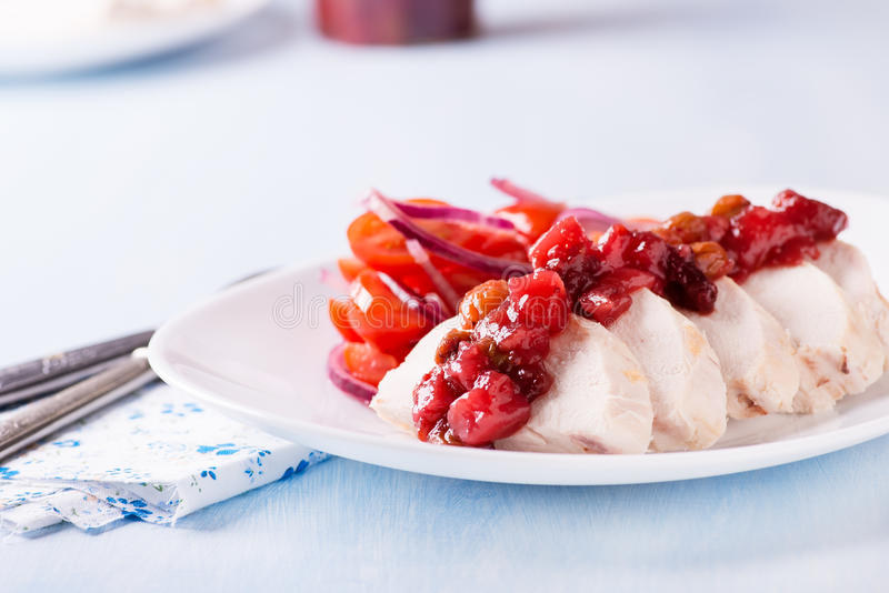 Chicken fillet with cranberry relish stock photo