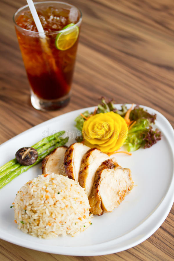 Chicken Fillet With Fried Rice And Lemon Tea Royalty Free ...