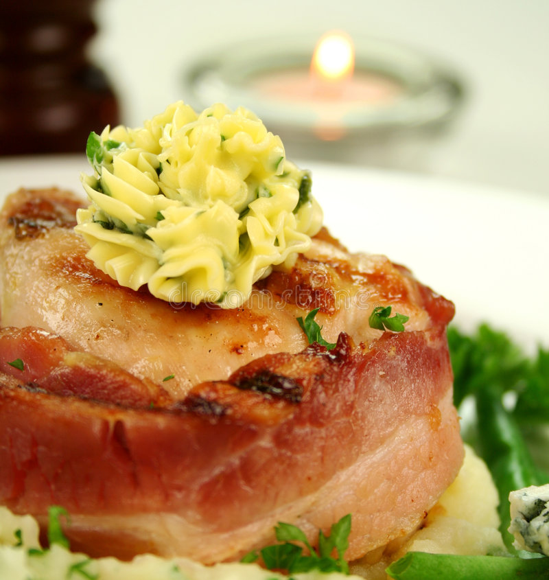 Chicken Fillet Mignon. Wrapped in bacon on parsley mashed potato with green beans stock photography