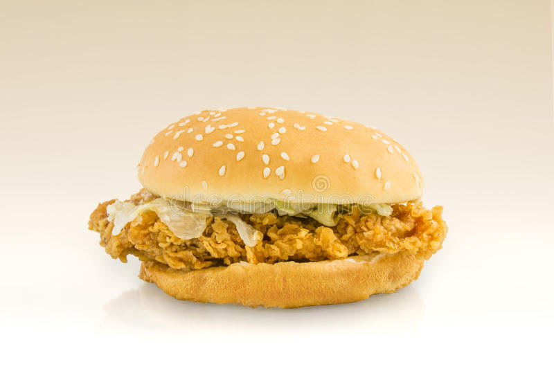 Chicken fried burger on brown background. Clipping path inside stock images