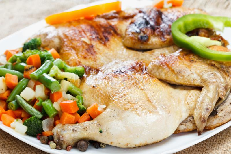 Chicken fried with vegetables on a napkin of burlap royalty free stock photography