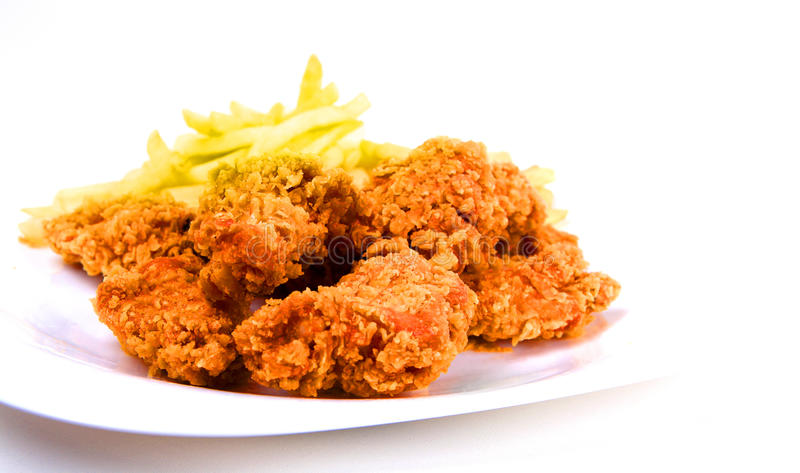 Chicken and fries. Chicken wings and fries on white stock photography