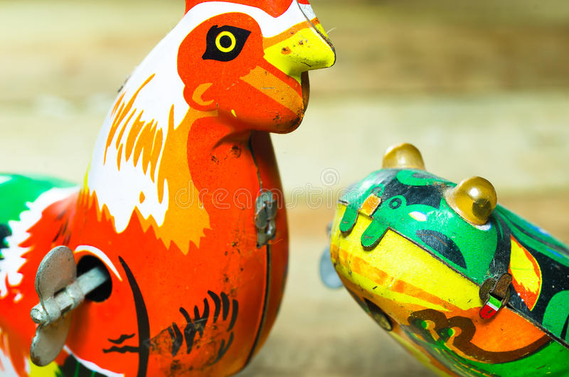 Chicken and frog Tin toys stock photography