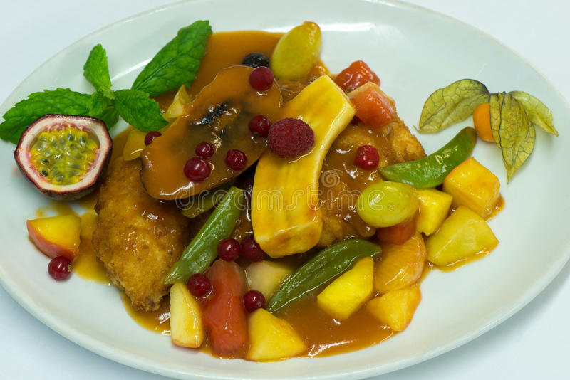Chicken with fruits stock image