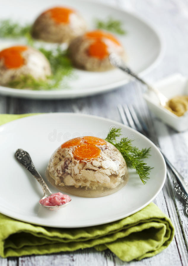 Chicken galantine aspic. Served on plate stock photos
