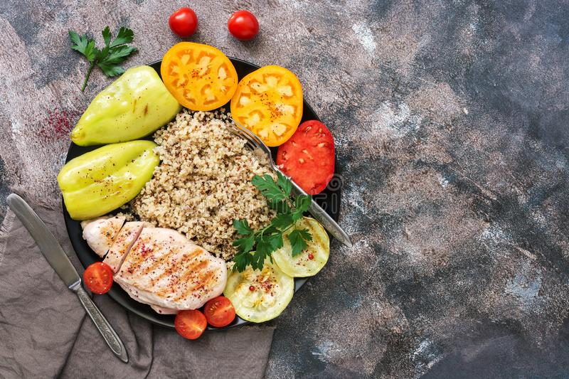 Chicken grilled fillet with quinoa and vegetables on a rustic background. Bowl of the buddha. The concept of healthy eating. View stock images