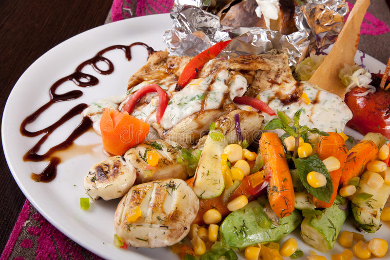 Chicken Grilled with vegetables stock photos