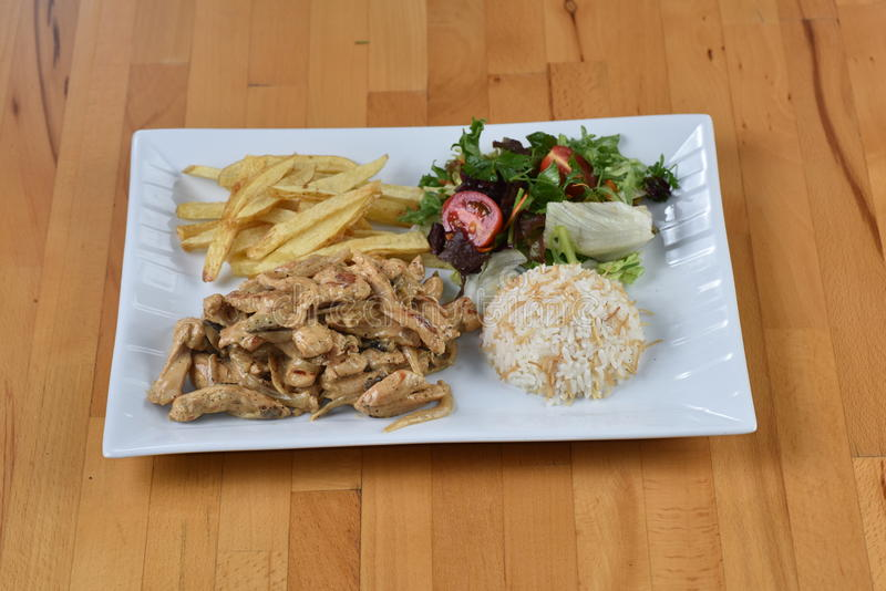 Chicken with Hardal Sauce. Served with potato, rice and salad stock photos