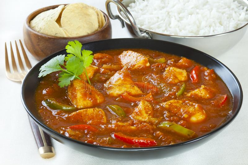 Chicken Jalfrezi Curry. Chicken Jalfrezi with rice and poppadums. This curry was invented by Indian chefs in the time of the Raj, when left over roast chicken stock photography