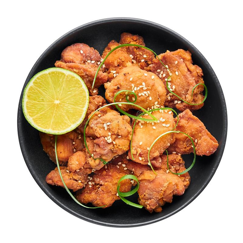 Chicken Karaage in black bowl isolated on white background. Karaage is traditional japanese cuisine dish stock image