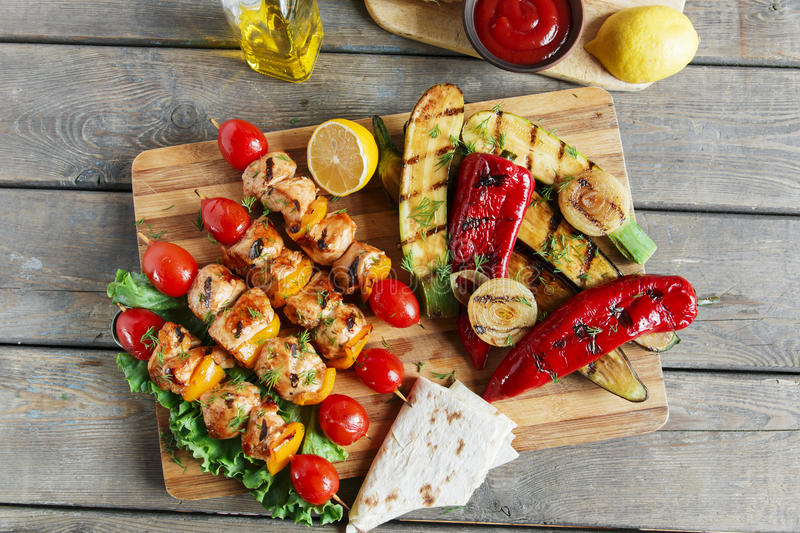 Chicken kebab skewer with grilled vegetables barbecue royalty free stock images