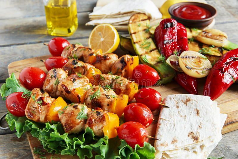 Chicken kebab skewer with grilled vegetables barbecue stock images