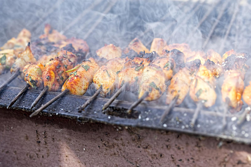 Chicken kebabs on barbecue royalty free stock images