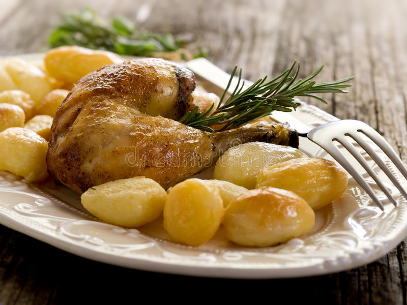 Download Chicken leg with potatoes stock image. Image of plate - 19035415