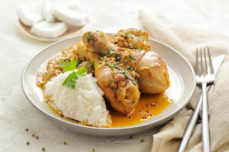 Chicken legs braised in curry and coconut sauce. royalty free stock photography