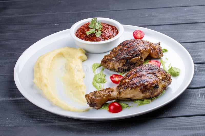 Chicken legs `Tabaka` with Georgian sauce royalty free stock photo