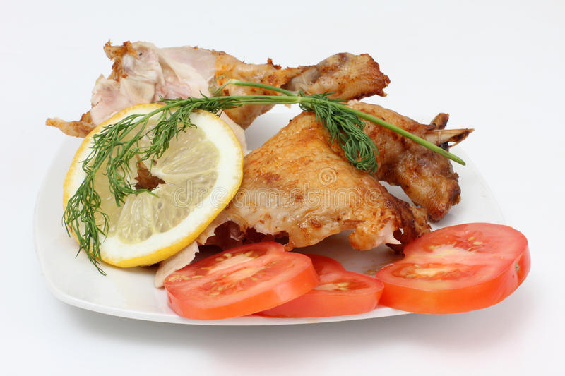 Chicken and lemon royalty free stock image