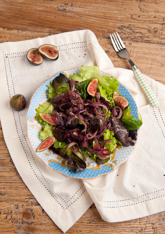 Chicken liver and fig salad royalty free stock photos