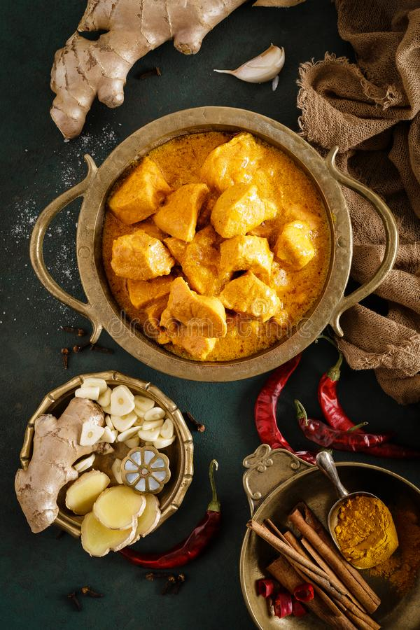 Chicken masala curry, spicy meat. Yellow chicken curry sauce. Spicy chicken curry dish. Traditional indian food, asian cuisine. Top view royalty free stock images