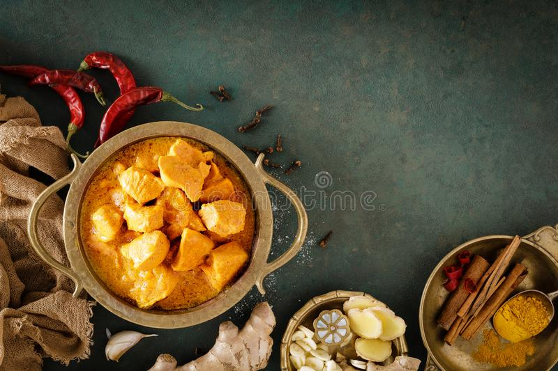Chicken masala curry, spicy meat. Yellow chicken curry sauce. Spicy chicken curry dish. Traditional indian food, asian cuisine. Top view stock photos