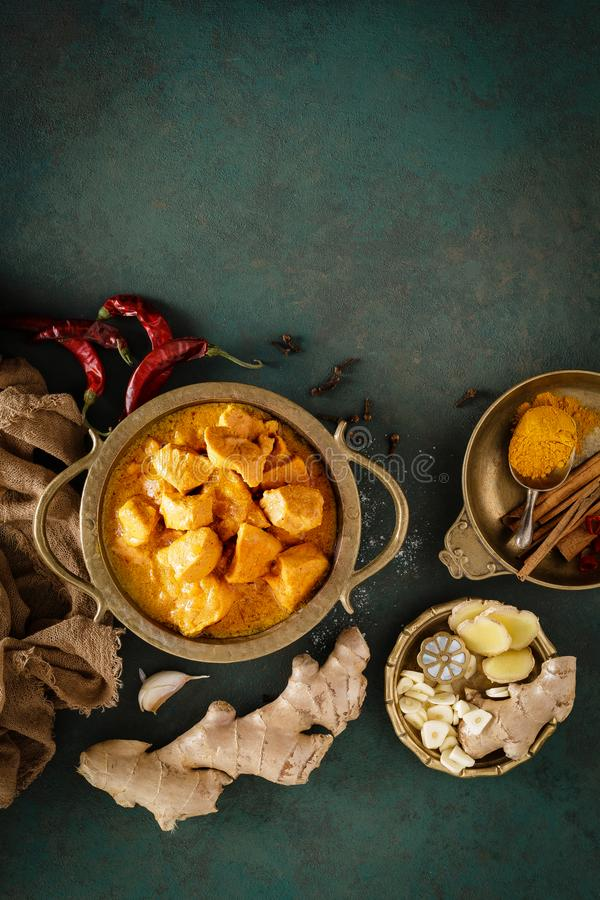 Chicken masala curry, spicy meat. Yellow chicken curry sauce. Spicy chicken curry dish. Traditional indian food, asian cuisine. Top view stock photography