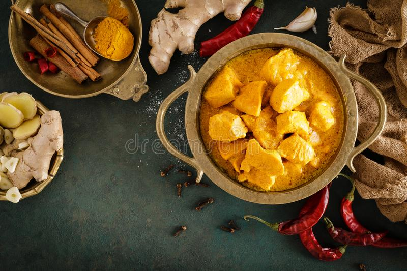 Chicken masala curry, spicy meat. Yellow chicken curry sauce. Spicy chicken curry dish. Traditional indian food, asian cuisine. Top view stock photo