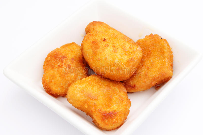 Chicken Mc Nuggets. Some fresh chicken mc nuggets royalty free stock photo