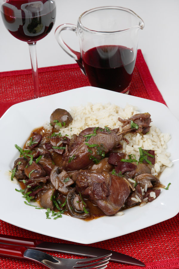 Chicken meat with mushrooms in red vine sauce royalty free stock photography
