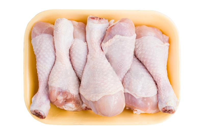 Chicken leg drumsticks in package box isolated on white background. Chicken meat package isolated on white background stock images