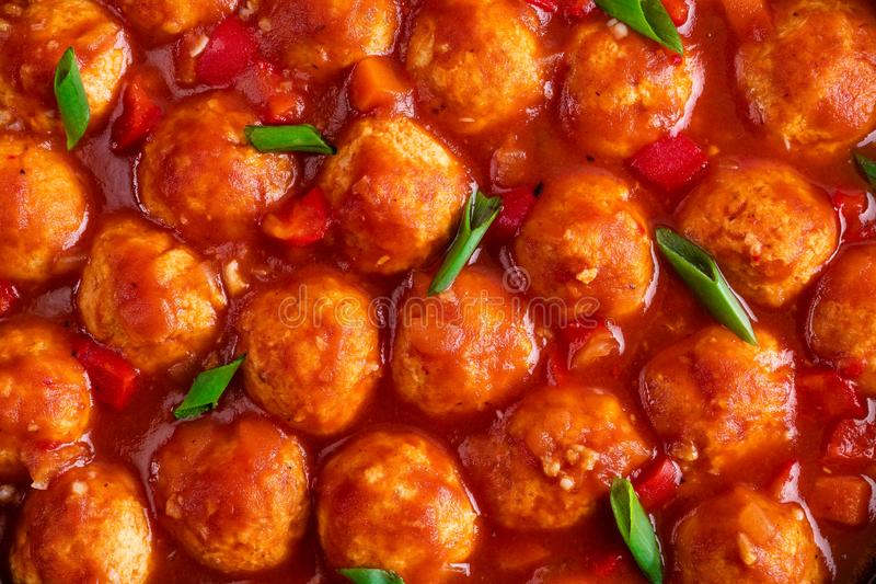 Chicken meatballs in spicy tomato sauce with vegetables. Mexican cuisine. Top view stock photography