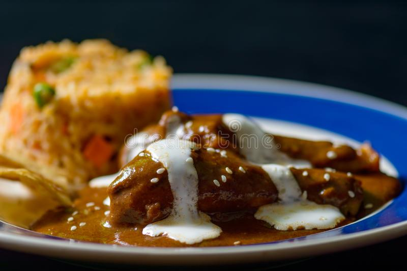 Chicken with mole Poblano sauce and Mexican rice royalty free stock photo