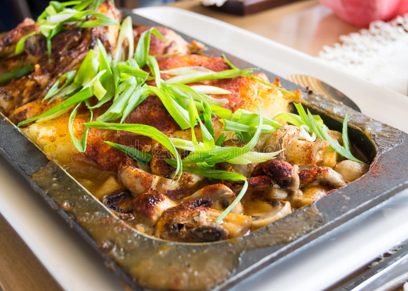 Chicken with mushrooms in pan stock photography