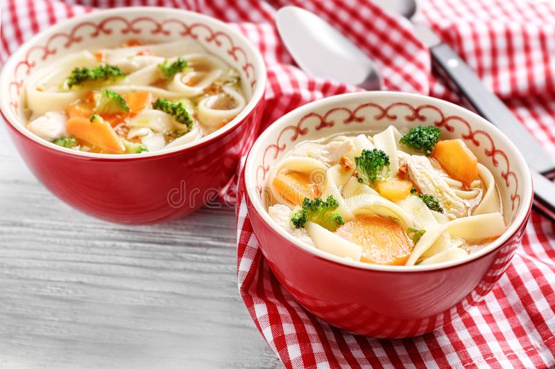 Chicken noodle soup in bowls royalty free stock photo