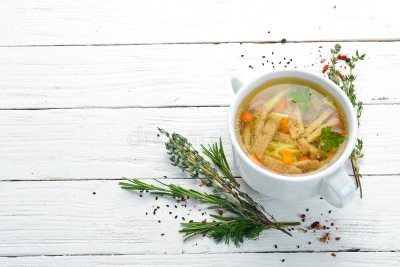 Chicken noodle soup. Dishes, food. Top view. Free space for your text royalty free stock photos