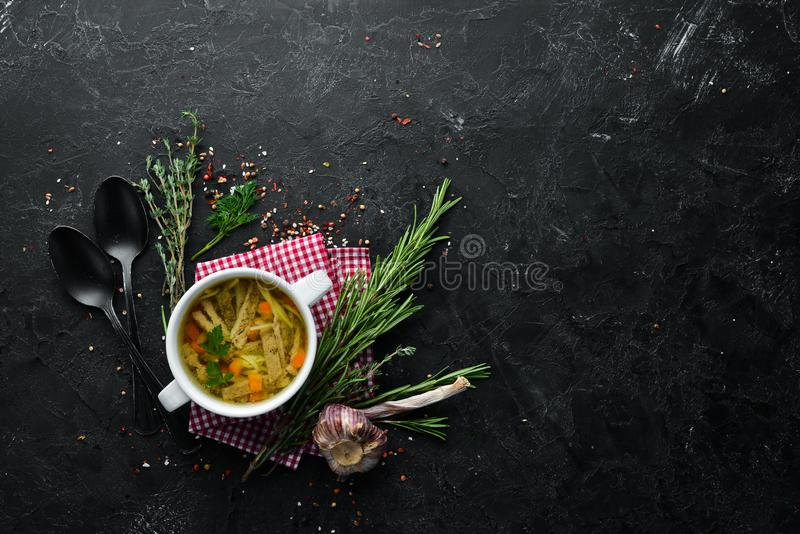Chicken noodle soup. Dishes, food. Top view. Free space for your text stock images