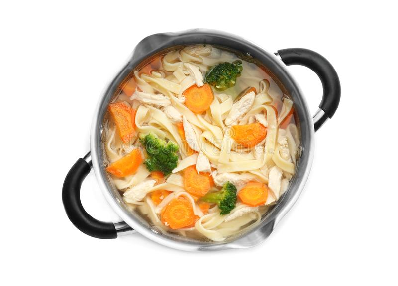 Chicken noodle soup in saucepan. On white background royalty free stock photography