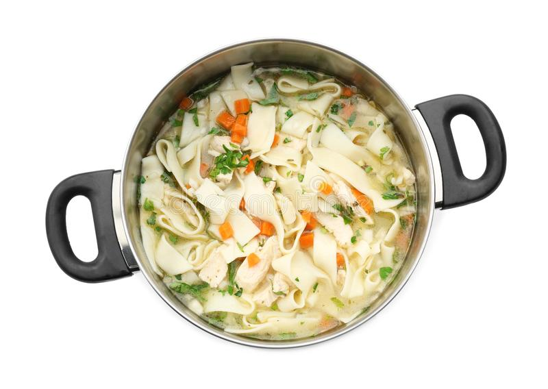 Chicken noodle soup in saucepan. On white background royalty free stock image