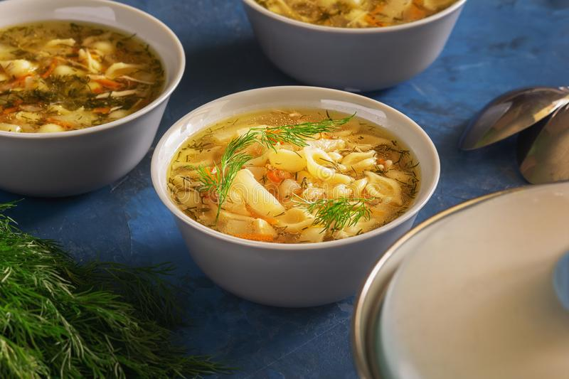 Chicken Noodle Soup with Vegetables Fresh Dinner. Homemade Healthy Meal Served in White Bowl. Poultry Broth with Traditional Pasta Closeup View. Branch of Dill royalty free stock photography