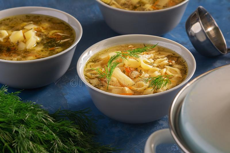 Chicken Noodle Soup with Vegetables Home Recipe. Homemade Healthy First Course Served in White Bowl. Poultry Broth with Traditional Pasta Elevated View royalty free stock photo