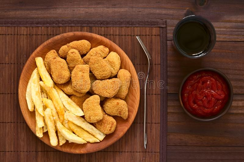 Chicken Nuggets and French Fries stock images