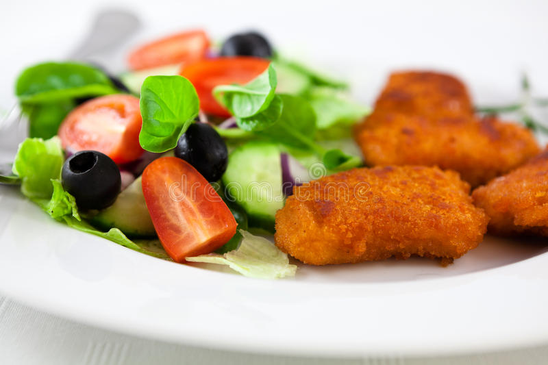 Chicken nuggets with salad stock photography