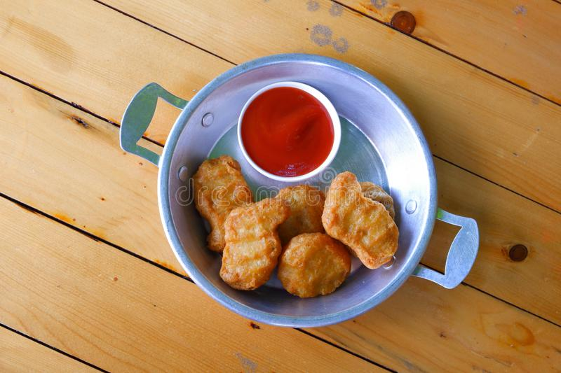 Chicken nuggets with tomato sauce. royalty free stock photography