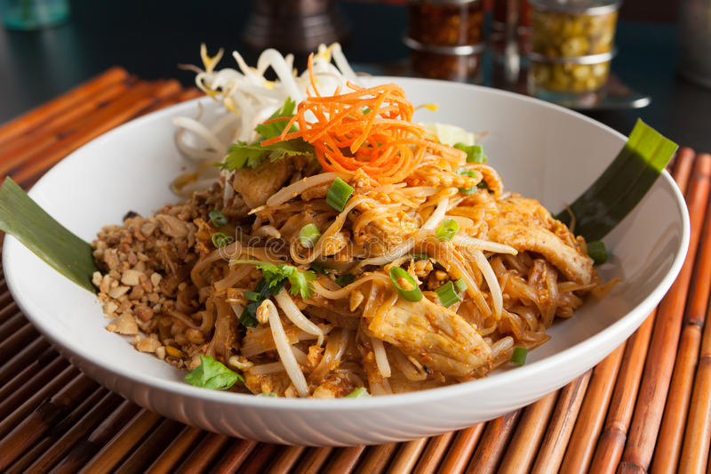 Chicken Pad Thai. Dish of stir fried rice noodles with a contemporary presentation royalty free stock photography